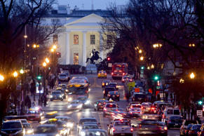 Traffic moves along 16th Street near the White House in Washington, D.C., U.S., on Thursday, Jan. 15, 2015.