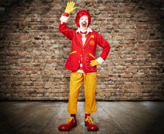 This image provided by McDonald's on Wednesday, April 23, 2014, shows the character Ronald McDonald with updated clothing.