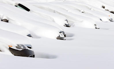 Cars sit buried by drifted snow Wednesday, Jan. 28, 2015, at a used auto dealer in Norwood, Mass., after a winter snowstorm slammed New England on Tuesday.  The storm buried the Boston area in more than 2 feet of snow and lashed it with howling winds that exceeded 70 mph.