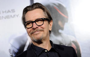 "Gary Oldman, a cast member in ""Robocop,"" poses at the premiere of the film on Monday, Feb. 10, 2014, in Los Angeles. (Photo by Chris Pizzello/Invision/AP)"