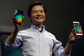 Lei Jun, chairman of Chinese smartphone maker Xiaomi, holds up the latest models of the Xiaomi Note at a press event in Beijing, Jan. 15, 2015.