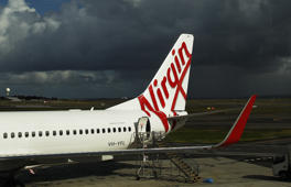 A Boeing Co. 737 aircraft operated by Virgin Australia Holdings Ltd. stands on the tarmac at the domestic terminal at Sydney Airport in Sydney, Australia.
