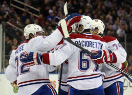 The Montreal Canadiens celebrate the game winning third period goal by Max Pacioretty #67 against the Montreal Canadiens at Madison Square Garden on January 29, 2015 in New York City. The Canadiens shutout the Rangers 1-0.