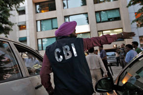 File: A Central Bureau of Investigation (CBI) official gestures outside the New Delhi office of the Abhijeet Group, which owns Jas Infrastructure, after conducting a raid on September 4, 2012.