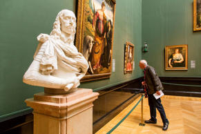 A senior enjoys art at a museum.