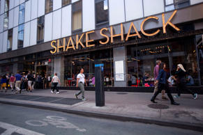 Pedestrians pass a Shake Shack restaurant in New York City on Sept. 10, 2014.