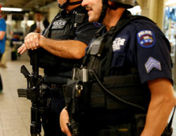 New York City Police officers stand guard in metro station in New York, United States on September 17, 2014.