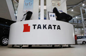 Displays of Takata Corp are pictured at a showroom for vehicles in Tokyo in this file photo taken November 5, 2014.