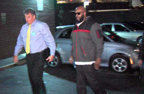 "This image from video shows Death Row Records founder Marion ""Suge"" Knight, right, walking into the Los Angeles County Sheriffs department Jan. 30, 2015 in connection with a hit-and-run incident that left one man dead and another injured."
