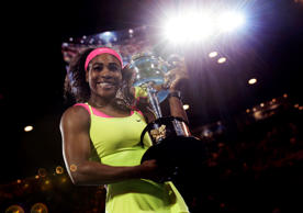 Serena Williams of the U.S. holds the trophy after defeating Maria Sharapova of Russia in the women's singles final at the Australian Open tennis championship in Melbourne, Australia, Saturday, Jan. 31, 2015.