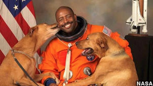 NASA Portrait Starring Astronaut And His Dogs Is Everything