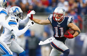 Julian Edelman #11 of the New England Patriots carries the ball during the fourth quarter against the Detroit Lions at Gillette Stadium on Nov. 23 in Foxboro, Mass.