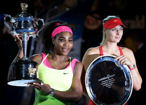 Serena Williams holds the trophy with runner-up Maria Sharapova after winning the women's singles final at the Australian Open tennis championship in Melbourne.