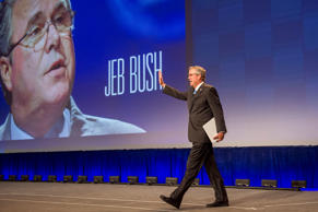 Jeb Bush, former governor of Florida, waves as he walks on stage during a keynote session at the National Automobile Dealer Association conference in San Francisco, California, Jan. 23, 2015.