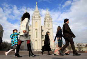 "In this April 5, 2014 file photo, people walk past the Salt Lake Temple in Salt Lake City. On Jan. 27, 2015, Mormon leaders made a national appeal for what they called a ""balanced approach"" in the clash between gay rights and religious freedom, promising to support some housing and job protections for gays if they back some exemptions for religious objectors to same-sex marriage."