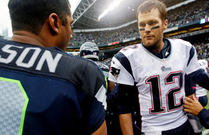 New England Patriots quarterback Tom Brady (12) talks with Seattle Seahawks quarterback Russell Wilson in Seattle after a game in 2012.