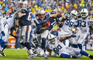 New England Patriots LeGarrette Blount (29) in action, rushing for his second touchdown as teammate Dan Connolly (63) blocks vs Indianapolis Colts D'Qwell Jackson (52) during 3rd quarter at Gillette Stadium. Score: 38-7.