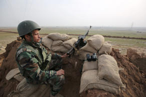A Kurdish Peshmerga soldier stands guard, overlooking the road between Mosul and Tal afar at the frontline of Eski Mosul on Jan. 27, 2015. The Iraqi Kurdish fighters retaking territory from Islamic State militants have found surprising ambivalence in areas they free from the jihadis' oppressive rule.