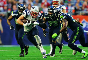 Rob Gronkowski #87 of the New England Patriots carries the ball against Kam Chancellor #31 of the Seattle Seahawks in the first quarter during Super Bowl XLIX at University of Phoenix Stadium on February 1, 2015 in Glendale, Arizona.