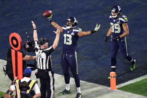 Seattle Seahawks wide receiver Chris Matthews (13) celebrates after scoring a touchdown during the second quarter against the New England Patriots in Super Bowl XLIX at University of Phoenix Stadium.