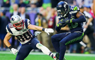 Jeremy Lane #20 of the Seattle Seahawks intercepts a ball over Danny Amendola #80 of the New England Patriots in the first quarter during Super Bowl XLIX at University of Phoenix Stadium on Feb. 1 in Glendale, Ariz.