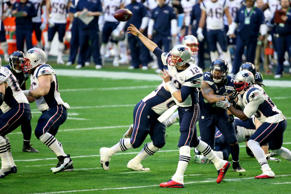 Tom Brady #12 of the New England Patriots throws a pass in the first quarter during Super Bowl XLIX at University of Phoenix Stadium on February 1, 2015 in Glendale, Arizona.