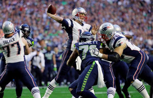 New England Patriots quarterback Tom Brady (12) throws a pass during the first half of NFL Super Bowl XLIX football game against the Seattle Seahawks on Sunday, Feb. 1, 2015, in Glendale, Ariz.