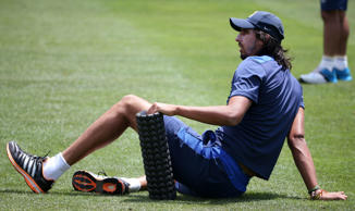 India's Ishant Sharma stretches during training for their cricket test match against Australia in Sydney, Sunday, Jan. 4, 2015.