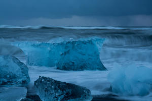Icebergs reaching the sea in Jokulsarlon glacial lagoon in southeast Iceland