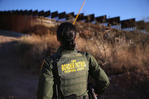 U.S. Border Patrol agent Nicole Ballistrea watches over the U.S.-Mexico border f...