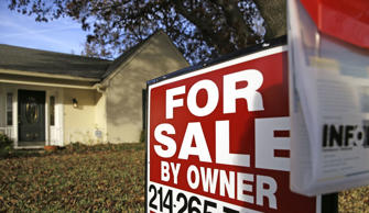 In this Dec. 16, 2014 file photo, a for sale by owner sign sits in front of a home in Richardson, Texas. Real estate data provider CoreLogic reports on November home prices on Tuesday, Jan. 6, 2015. (AP Photo/LM Otero, File)