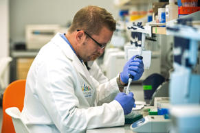Reserach technicians prepare DNA samples to be sequenced in the production lab of the New York Genome Center in New York City.