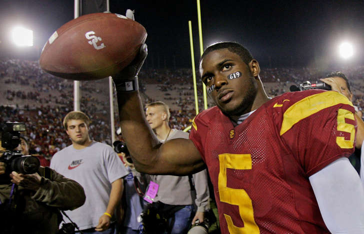 Southern California tail back Reggie Bush walks off the field holding the game ball after the Trojans defeated Fresno State, 50-42, Saturday, Nov. 19, 2005, at the Los Angeles Coliseum. Bush rushed for 294-yards and scored two touchdowns.