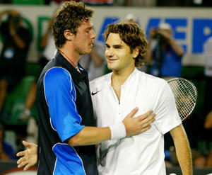 Marat Safin of Russia, fourth seed, left, and Roger Federer of Switzerland, top seed, exchange words, after their mens singles semifinal match, at the Australian Open on Rod Laver Arena at Melbourne Park, Melbourne, Australia, Thursday, Jan. 27, 2005. Safin won in five sets, 5-7, 6-4, 5-7, 7-6, 9-7. (AP Photo/Tony Feder)