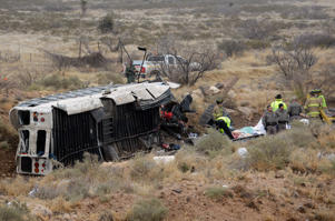 Authorities at the scene of a prison transport bus which fell onto train tracks near Penwell, Texas, January 14, 2015.