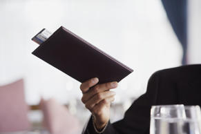 Businessman paying the check at restaurant.