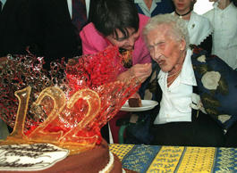 Jeanne Calment, believed to be the world's oldest person, eats a piece of  chocolate cake she received to mark her 122nd birthday in Arles, southern France, Friday February 21, 1997.