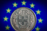 In this photo illustration a 5 Swiss Franc Coin stands in front of the flag of European Union on January 20, 2015 in Berlin, Germany.