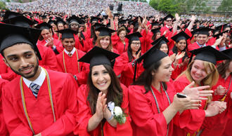 Graduates at Boston University's commencement ceremony on Nickerson Field in Boston, Mass