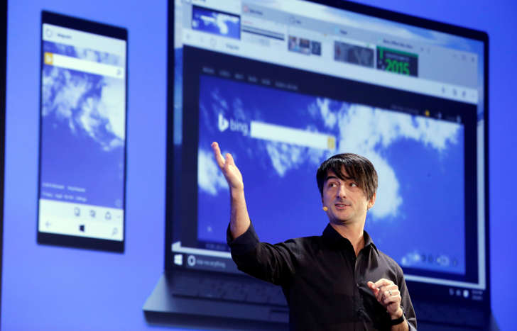 Microsoft's Joe Belfiore, corporate vice president of Operating Systems Group, speaks at an event demonstrating new features of its flagship operating system Windows at the company's headquarters Wednesday, Jan. 21, 2015, in Redmond, Wash. Executives demonstrated how they said the new Windows is designed to provide a more consistent experience and a common platform for software apps on different devices, from personal computers to tablets, smartphones and even the company's Xbox gaming console. (AP Photo/Elaine Thompson)