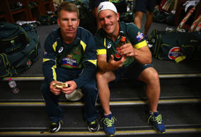 David Warner and Aaron Finch of Australia celebrate in the change rooms after game five of the One Day International series between Australia and South Africa at Sydney Cricket Ground on November 23, 2014 in Sydney, Australia.