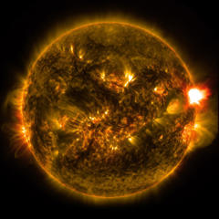 This Monday, Jan. 12, 2015 photo provided by NASA shows the first notable solar flare of the year, as observed from NASA's Solar Dynamics Observatory. NASA's Solar Dynamics Observatory (SDO) is a NASA mission which has been observing the sun since 2010.