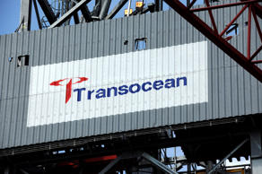 Logo of Transocean, the world's largest offshore driller, seen on the Transocean Siam Driller jackup rig docked at the Keppel FELS yard in Singapore.