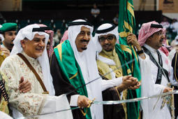 Saudi Prince al-Faisal and Saudi Prince Salman perform a traditional dance on the outskirts of Riyadh