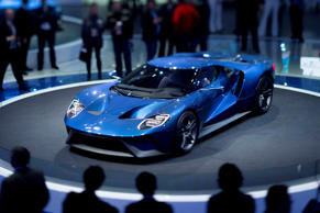 Attendees view the Ford Motor Co. GT vehicle in this photo taken with a tilt-shift lens during the 2015 North American International Auto Show (NAIAS) in Detroit, Michigan, U.S., on Tuesday, Jan. 13, 2015.