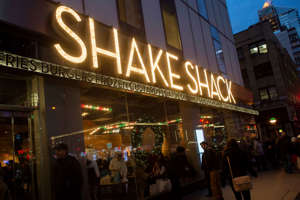 Passersby walk in front of the Shake Shack restaurant in the Manhattan borough of New York.