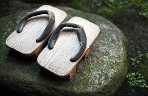A pair of geta sandals, a form of traditional Japanese footwear, seen at a ryokan in Kyoto, Japan.