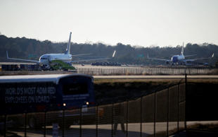 "A Delta airplane at left and a Southwest airplane at right sit on the tarmac at Hartsfield-Jackson Atlanta International Airport, Saturday, Jan. 24, 2015, in Atlanta. Police were searching the two planes at Atlanta's main airport after authorities received what they described as ""credible"" bomb threats."