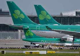 Ground crew are seen parking an Aer Lingus Airbus A320 away from the passenger terminals at Dublin Airport, in the Republic of Ireland in this June 2, 2002 file photograph.