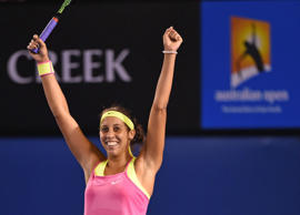 Madison Keys of the US celebrates after victory in her women's singles match against Czech Republic's Petra Kvitova on day six of the 2015 Australian Open tennis tournament in Melbourne on January 24, 2015.